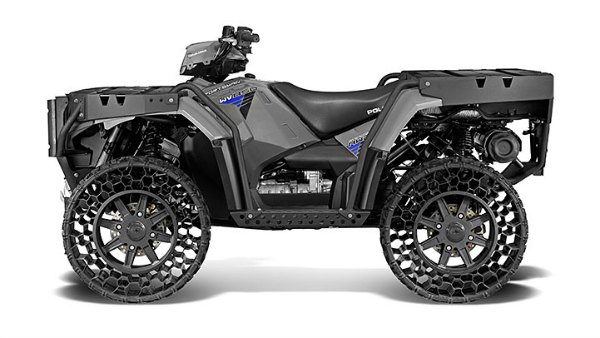 Quad Sportsman Polaris with airless wheels, not pneumatic