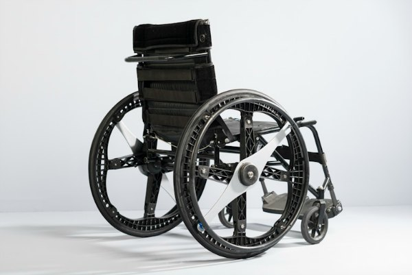 Wheelchair with folding wheels