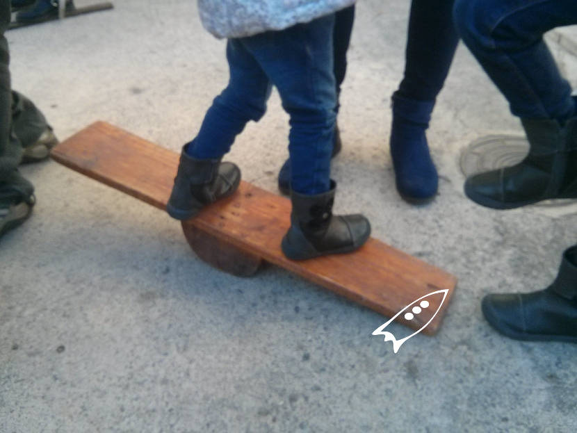 Wooden seesaw to learn to maintain balance